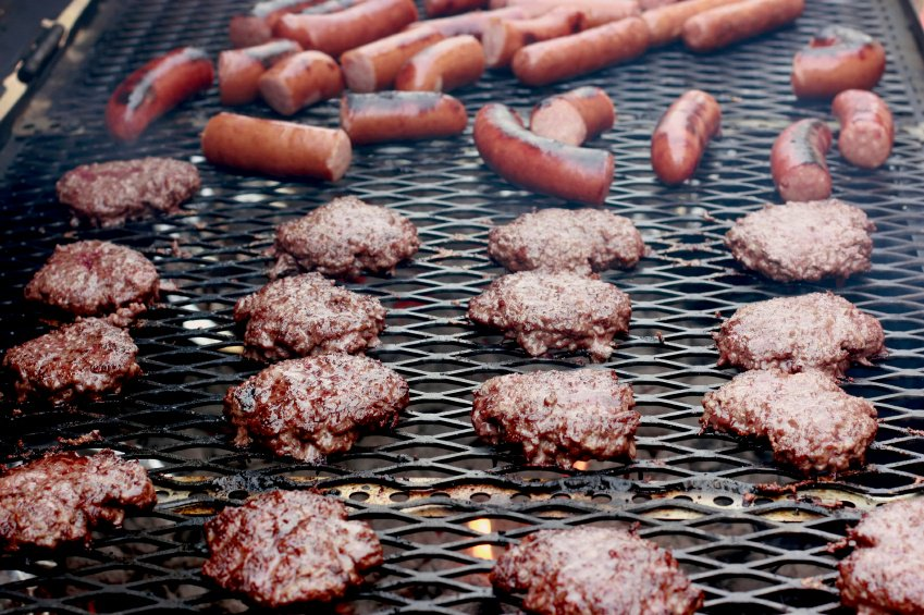 Burgers and hot dogs on a grill